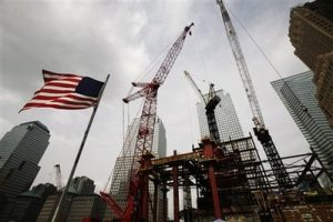 Construction cranes work above the Freedom Tower at the World Trade Center, Tuesday, Sept. 8, 2009, in New York.