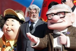 Film director George Lucas flanked by characters from animated movie upon arrival for the presentation of the Golden Lion for life-time achievements.