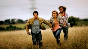 Mark Wahlberg, as Cade Yeager, Nicola Peltz as Tessa Yeager, and T.J. Miller as Lucas Flannery, in Transformers: Age of Extinction. (AP Photo)