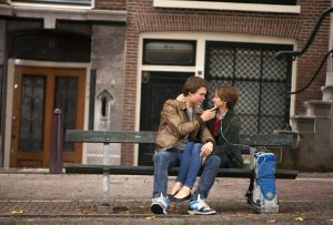 Ansel Elgort, left, and Shailene Woodley, right, share a kiss in Amsterdam (AP Photo)