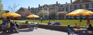 Students enjoying a break in the Maxcy Quad outside the Bartel's Hall Campus Center on UNH's main campus. (UNH Photo)