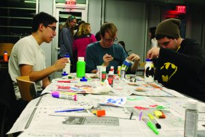 Students decorating their reusable water bottles Thursday night  (Erica Naugle/ Charger Bulletin Photo)