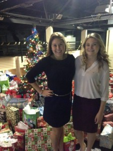 Phi Sig Fundraising Chair Paula Aulestia and sister Maddie DiPrima standing among the piles of donated gifts  (Photo provided by Paula Aulestia)