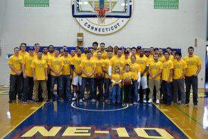 The Men's Basketball team and Colin's Crew  (Photo obtained via the UNH Men's Basketball Facebook)