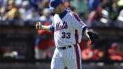 New York Mets starting pitcher Matt Harvey punches his fist into his glove during the sixth inning of the baseball game against the Philadelphia Phillies at Citi Field, Sunday, April 10, 2016, in New York. (AP Photo/Seth Wenig)