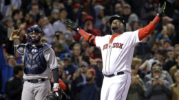 Boston Red Sox designated hitter David Ortiz celebrates his two-run home run as New York Yankees catcher Brian McCann waits during the eighth inning of a baseball game at Fenway Park on Friday, April 29, 2016, in Boston. The Red Sox won 4-2. (AP Photo/Elise Amendola)