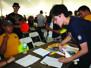 A student signs up for a club at the annual Clubs and Organizations Fair on Tuesdays, August 25, 2009. 80 clubs and organizations were present (over 55% were USGA-recognized clubs), as were a half dozen vendors.