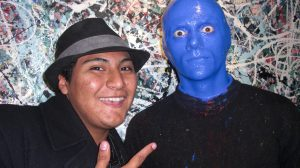 Charger Bulletin staff writer Stephen Acevedo with a member of The Blue Man Group after their show, sponsored by SCOPE, on Saturday, Oct. 17.  (A Maideline Sanchez/Charger Bulletin Photo)