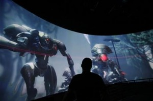 """Alex Beckers watches a presentation on the video game """"Destiny"""" at the Activision Blizzard Booth during the Electronic Entertainment Expo in Los Angeles (AP photo)"""