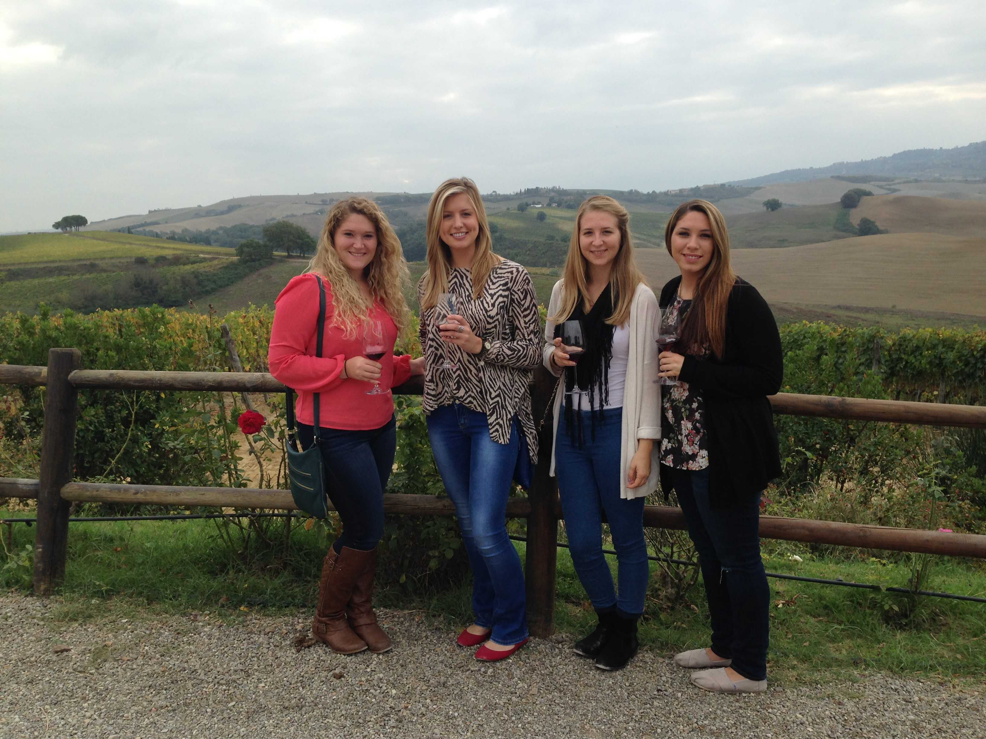 Students in Italy enjoy wine tasting on a Tuscany hillside  (Photo by Ashley Arminio/Charger Bulletin photo)