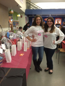 Ashley Higgins, a sister of Phi Sig (left) and the event coordinator, Kaie McNamara (right) in front of the prize table (Photo by Francesca Fontanez)