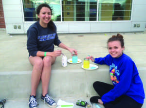 Katie O'Connor (left) and Liz Rourk (Right) members of TWLOHA decorating mason jars for the Lanterns of Love event (Photo by Francesca Fontanez)