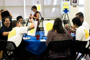 Families painting Minions in the Alumni Lounge (Photo by Sam Reposa/Charger Bulletin photo)
