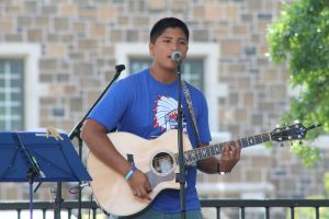 UNH Student Geodann Daguplo played the acoustic guitar during WestFest
