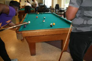 Students playing pool in the Bergami Game Room  (Photo by Ashley Wemmell/Charger Bulletin photo)