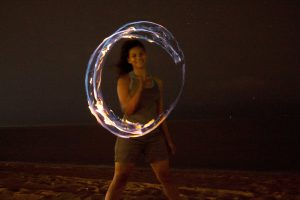 A fire spinner, Anna, performed for Erica and the others on the Strand (Photo by Erica Naugle/Charger Bulletin photo)