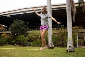 """Erica testing her balancing skills on a 1"""" slack line (Photo by Erica Naugle/Charger Bulletin photo)"""