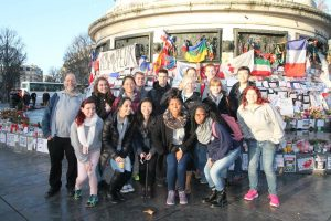 The students at the Bastille, after the market day, in front of the tributes to peace/victims of the terrorist attacks (Photo provided by Alyssa MacKinnon)