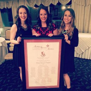 The Alpha Sigma Alpha Leadership Consultants pose with the Theta Omega charter From left to right, Kelly Taveras, Abby Somers and Aubrey Winn  (Photo provided by Abby Somers via Facebook)