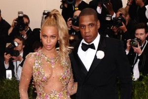 Jay-Z, creator of Tidal, with his wife, Beyonce  (AP photo)