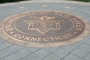 The new UNH logo that can be found in front of Maxcy Hall